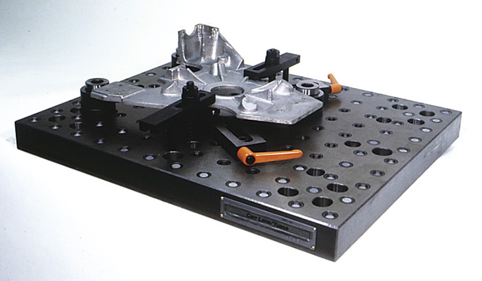 Irregularly shaped parts, such as this casting, can be clamped directly to a modular baseplate. Image courtesy Carr Lane Manufacturing.