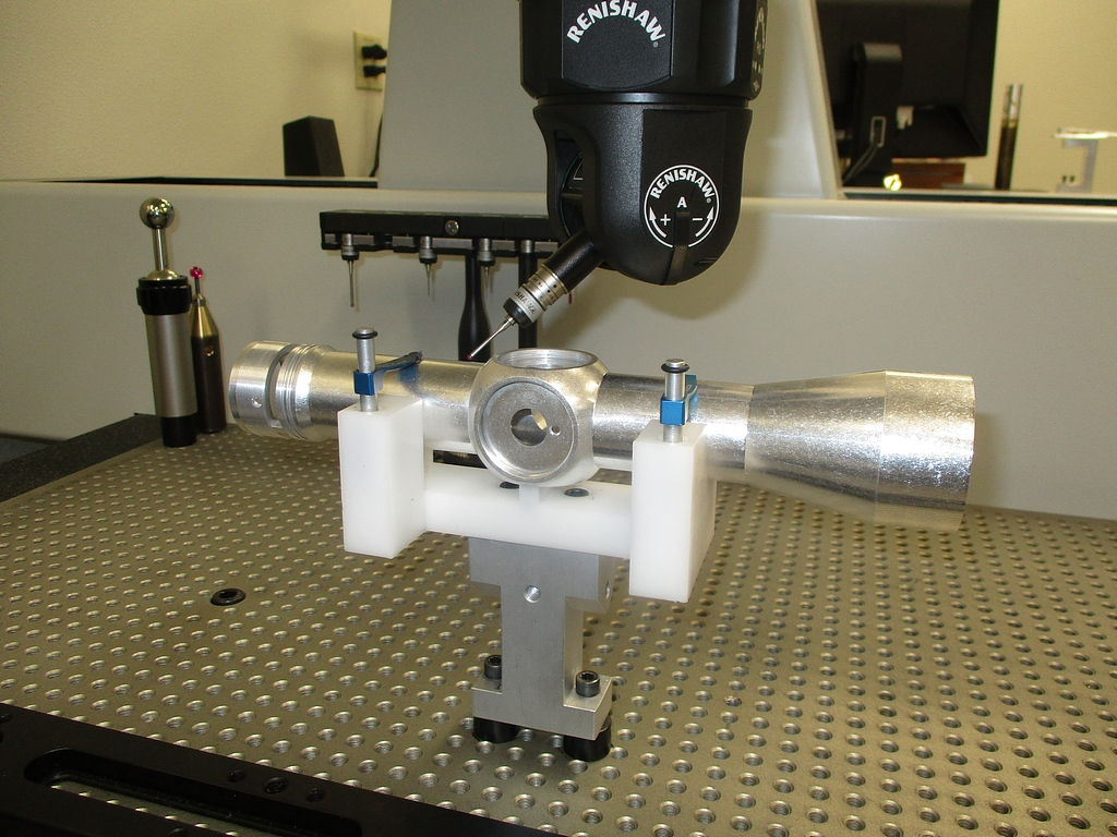 Different riflescope components being measured by the LK Metrology  Altera 'S' CMM